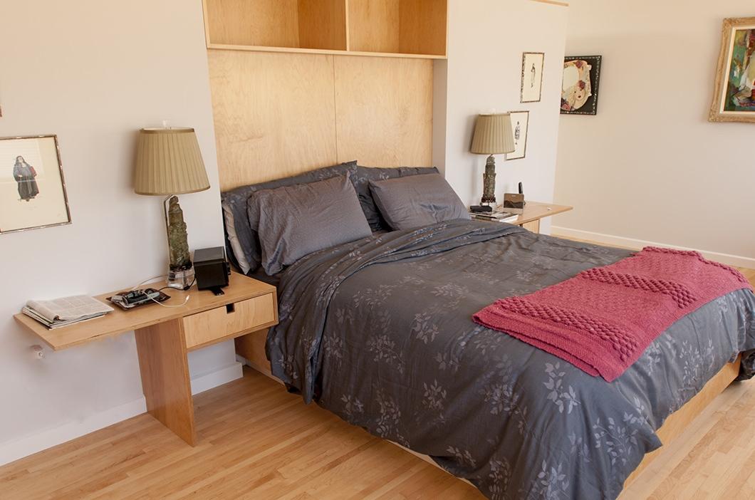 Master bedroom with built-in headboard and nightstands