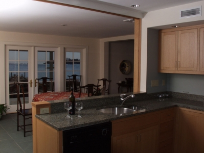 View from kitchen (oak paneled sliding wall shown open)